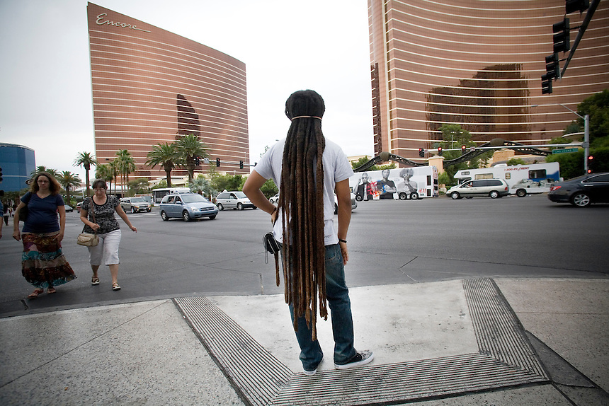A man with long dread locks at an intersection in Las Vegas, Nevada.