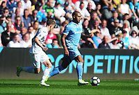 Stoke City's Glen Johnson under pressure from Swansea City's Tom Carroll<br /> <br /> Photographer Kevin Barnes/CameraSport<br /> <br /> The Premier League - Swansea City v Stoke City - Saturday 22nd April 2017 - Liberty Stadium - Swansea<br /> <br /> World Copyright &copy; 2017 CameraSport. All rights reserved. 43 Linden Ave. Countesthorpe. Leicester. England. LE8 5PG - Tel: +44 (0) 116 277 4147 - admin@camerasport.com - www.camerasport.com