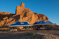 Mongolia, Gobi Gurvan Saikhan National Park, Gobi Desert, Flaming Cliffs. First nest of dinosaur eggs were found here in 1923. Three Camel Lodge tent set up for dinner.