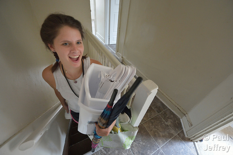 Emilie MacDonald carries household supplies up the stairs of an apartment in Lancaster, Pennsylvania. She is furnishing the apartment of a refugee family about to arrive in the United States. MacDonald works for Church World Service, which resettles refugees in Pennsylvania and other locations in the United States. <br /> <br /> Photo by Paul Jeffrey for Church World Service.