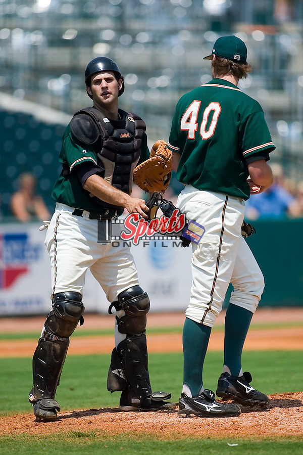 Greensboro catcher Daniel Santin (7) gives some encouragement to starting pitcher Kyle Winters (40) versus the Rome Braves at First Horizon Park in Greensboro, NC, Wednesday, August 15, 2007.
