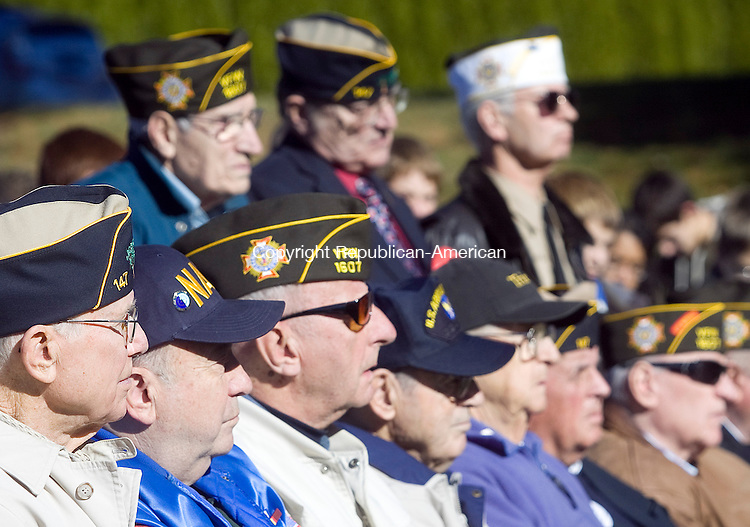 SOUTHBURY CT.-11 NOVEMBER 2010 111110DA06- Veterans listen to a speaker during a Veterans Day ceremony held at the Southbury Veterans Memorial Park on Thursday. 8th-grade students from Rochambeau Middle School were on hand to honor and say thank you to the men and women who have served our country.<br /> Darlene Douty Republican American
