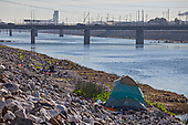 Homless tent along the Los Angeles River, Willow Street, Long Beach, Califortnia, USA,
