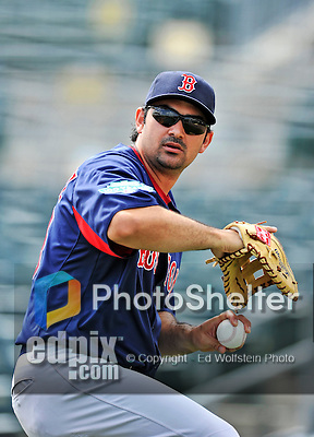 8 March 2012: Boston Red Sox first baseman Adrian Gonzalez warms up prior to a Spring Training game against the St. Louis Cardinals at Roger Dean Stadium in Jupiter, Florida. The Cardinals defeated the Red Sox 9-3 in Grapefruit League action. Mandatory Credit: Ed Wolfstein Photo