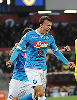 Vlad Chireches celebrates after scoring during the  italian serie a soccer match,between SSC Napoli and Chievo Verona      at  the San  Paolo   stadium in Naples  Italy , March 05, 2016<br /> Napoli won  3 - 1