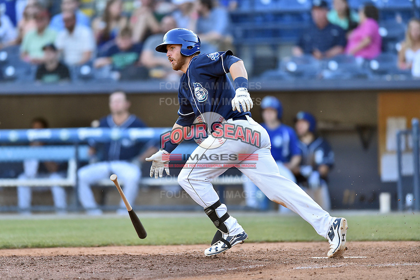 Asheville Tourists first baseman Brian Mundell (15) starts down the first base line during a game against the Hagerstown Suns at McCormick Field on April 28, 2016 in Asheville, North Carolina. The Tourists were leading the Suns 6-5 when the game was delayed in the top of the 6th inning due to darkness. (Tony Farlow/Four Seam Images)