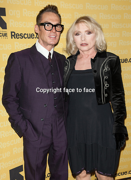 NEW YORK, NY - NOVEMBER 6, 2013: Todd Thomas and Debbie Harry attend the 2013 International Rescue Committee Freedom Award Benefit at The Waldorf Astoria on November 6, 2013 in New York City. <br />