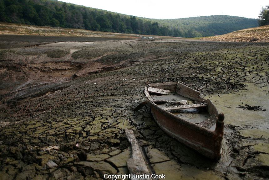 A sunken boat at the bottom of the empty lake bed at Mountain Lake Resort and Conservancy, Giles County, Virginia.
