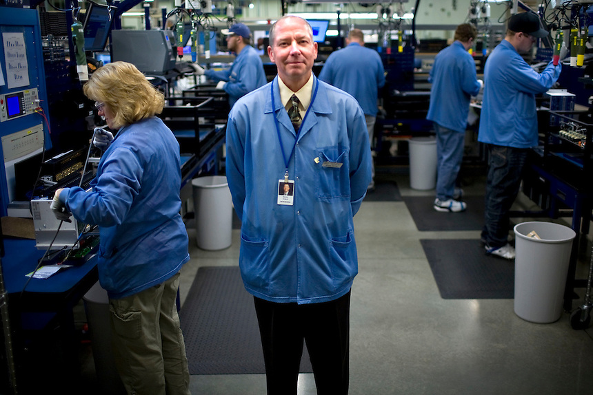 "Kevin Fritch, Vice-President of Operation at Schweitzer Engineering Laboratories stands for a portrait on the company's manufacturing floor in Pullman, Wash. ""We have a sales meeting today and another one next week,"" said Fritch. ""Business is good.""..(Matt Mills McKnight for The Wall Street Journal)"
