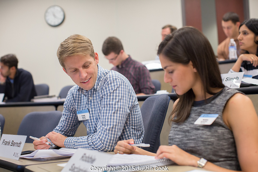 MBA students Frank Berndt and Robbie Saclarides in Mark Lang's class at the McColl Building at the Kenan-Flagler Business School at The University of North Carolina at Chapel Hill in Chapel Hill, NC on Friday, July 24, 2015. (Justin Cook for The Wall Street Journal)<br /> <br /> Story Summary: Students are showing up early on business-school campuses, even when they don&rsquo;t have to. At schools like UNC Chapel-Hill&rsquo;s Kenan-Flagler Business School and NYU Stern, summer sessions&mdash;intended to get students without business backgrounds up to speed before the semester begins&mdash;are growing in popularity as even finance whizzes say they don&rsquo;t want to miss the chance to polish their job-search plans and socialize with their new classmates.
