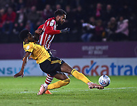 Lincoln City's Matt Green is denied a good opportunity by Wolverhampton Wanderers U21's Cameron John<br /> <br /> Photographer Andrew Vaughan/CameraSport<br /> <br /> The EFL Checkatrade Trophy Northern Group H - Lincoln City v Wolverhampton Wanderers U21 - Tuesday 6th November 2018 - Sincil Bank - Lincoln<br />  <br /> World Copyright © 2018 CameraSport. All rights reserved. 43 Linden Ave. Countesthorpe. Leicester. England. LE8 5PG - Tel: +44 (0) 116 277 4147 - admin@camerasport.com - www.camerasport.com