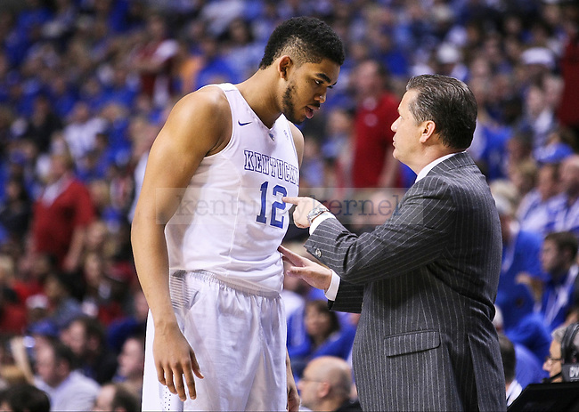 Kentucky head coach John Calipari takes a moment to talk to Karl-Anthony Towns during the second half of the Championship game of the SEC tournament against Arkansas in Nashville , Tenn., on Sunday, March 15, 2015. Photo by Jonathan Krueger | Staff