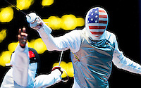 31 JUL 2012 - LONDON, GBR - Miles Chamley-Watson (USA) (right) of the USA fails to avoid a lunge from Alaaeidin Abouelkassem (EGY) of Egypt during their round of 32 men's individual foil match at the ExCel Exhibition Centre in London Docklands, London, Great Britain (PHOTO (C) 2012 NIGEL FARROW)