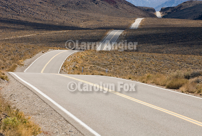 State Route Highway 190 rolls over the hills east of Owens Lake toward the Talc City Hills, Calif.