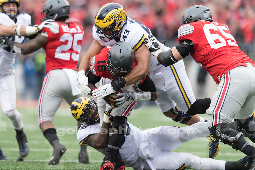 The University of Michigan football team loses to Ohio State University, 30-27 in double overtime, at Ohio Stadium in Columbus on Nov. 26, 2016.