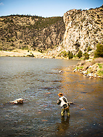 An angler cast to rising trout in Bear Trap Canyon on the Madison River near Bozeman, Montana.