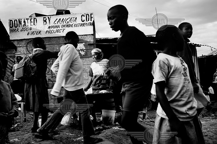 Clarissa Adiambo selling fish on the street near her home in Kibera.