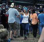 Members of the audience dancing during performance by Railroad Earth, at  the West Stage of the Mountain Jam Music Festival of 2015, in Hunter, NY, on Thursday June 4, 2015. Photo by Jim Peppler. Copyright Jim Peppler 2015.