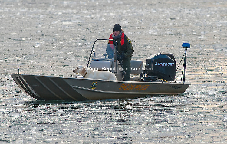BARKHAMSTED,  CT-010215JS04--An officer with ENCON Police and search and rescue dog, make their way on West Hill Pond on Friday as emergency personnel search for a missing kayaker. <br /> Jim Shannon Republican-American