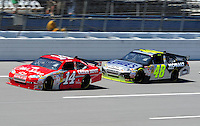 Apr 24, 2009; Talladega, AL, USA; NASCAR Sprint Cup Series driver Tony Stewart leads Jimmie Johnson during practice for the Aarons 499 at Talladega Superspeedway. Mandatory Credit: Mark J. Rebilas-