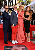 LOS ANGELES, CA. October 10, 2019: Tommy Mottola, Tommy Hilfiger, Dee Ocleppo Hilfiger & Thalia Mottola at the Hollywood Walk of Fame Star Ceremony honoring Tommy Mottola.<br /> Pictures: Paul Smith/Featureflash
