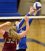 NWA Democrat-Gazette/BEN GOFF @NWABENGOFF<br /> Samantha Lassiter of Rogers hits the ball over as Haley Stewart of Siloam Springs defends on Thursday Aug. 27, 2015 during the match at Rogers High.