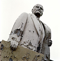 Weathered statue of Vladimir Lenin in a deserted Russian army barracks.  The Cold War, which formed part of the collective consciousness of post war Europe from 1945 until 1989 dominated the military and political landscape.  Often highly charged with nationalistic zeal, Soviet rhetoric and paranoia, relics of the Cold War remain as testaments to the covert era within Eastern Europe. CHECK with MRM/FNA