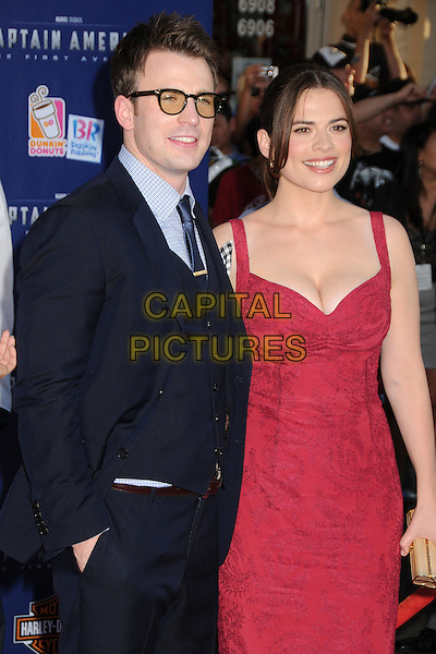 "Chris Evans & Hayley Atwell.Premiere of ""Captain America: The First Avenger"" held at The El Capitan Theatre in Hollywood, California, USA..July 19th, 2011.half length suit dress pink waistcoat smiling glasses black blue suit .CAP/ADM/BP.©Byron Purvis/AdMedia/Capital Pictures."