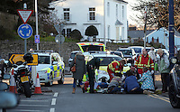 Police and ambulance crews attend an RTA in Mumbles, near Swansea, south Wales, UK