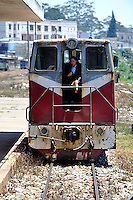 Very old diesel locomotive and railway guard, at Da Lat Railway Station. The Da Lat station is the oldest railway station in Vietnam, having been built during the French occupation of Vietnam. Da Lat, Vietnam