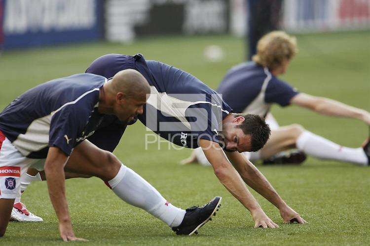 The Chicago Fire's Ante Razov talks with teammate C.J. Brown with  Jim Curtin in the background. The Chicago Fire played the NY/NJ MetroStars to a one all tie at Giant's Stadium, East Rutherford, NJ, on May 15, 2004.