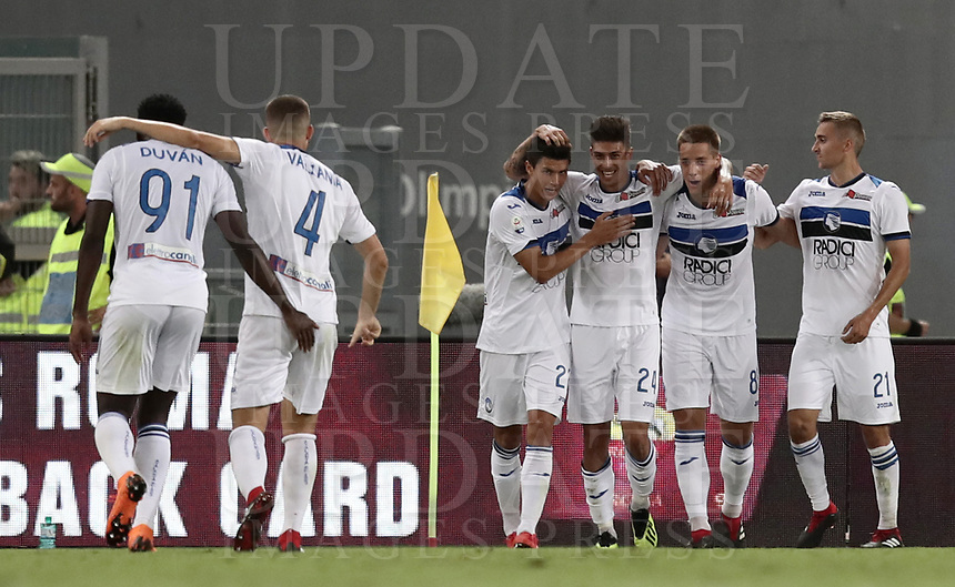 Calcio, Serie A: Roma - Atalanta, Stadio Olimpico, 27 agosto, 2018.<br /> Atalanta's Emiliano Rigoni (third from right) celebrates his second goal in the match with his teammates during the Italian Serie A football match between Roma and Atalanta at Roma's Stadio Olimpico, August 27, 2018.<br /> UPDATE IMAGES PRESS/Isabella Bonotto
