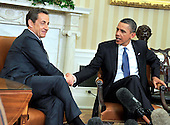 United States President Barack Obama, right, shakes hands with President Nicolas Sarkozy of France, left, after their bilateral meeting  in the Oval Office of the White House in Washington, D.C. on Monday, January 10, 2011..Credit: Ron Sachs / Pool via CNP