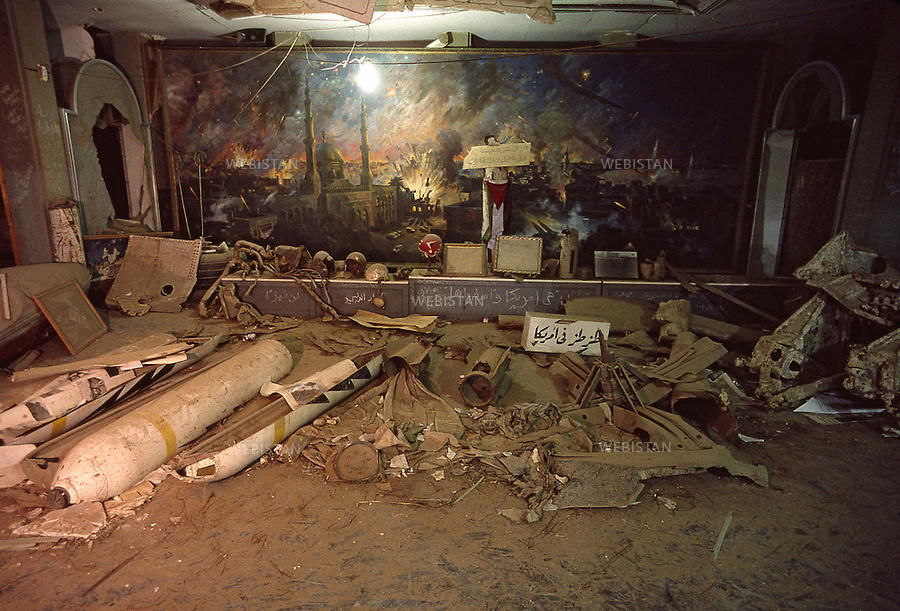 LIBYA, TRIPOLI, AL-GADDAFI'S HOUSE, 2000. View of ruined room inside the house of Al-Gaddafi. The house was ruined after the 1986 United States bombing of Tripoli and Benghazi.<br /> <br /> LIBYE, TRIPOLI, MAISON DE KADHAFI, 2000. Vue d'une pi&egrave;ce d&eacute;vast&eacute;e de la demeure du leader Libyen Mouammar Abu Minyar Kadhafi. Celle-ci fut en partie detruite par les bombardements americains en 1986 des villes de Tripoli et de Benghazi.
