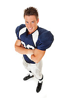 Caucasian American football player, in uniform, isolated on white, with various related props.