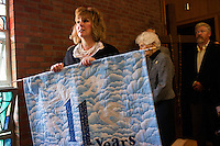 "Surrounded by her family, Maryellen Rogers, of Scituate, holds a quilt marking 11 years of the vigil during the final moments of the last service at St. Frances Xavier Cabrini Church in Scituate, Mass., on Sun., May 29, 2016. Maryellen and her husband Jon Rogers have served as spokespeople for the congregation. Quilts marking each year of the vigil were hung on the walls of the church until the final service. Members of the congregation have been holding a vigil for more than 11 years after the Archdiocese of Boston ordered the parish closed in 2004. For 4234 days, at least one member of Friends of St. Frances X. Cabrini has been at the church at all times, preventing the closure of the church. May 29, 2016, was the last service held at the church after members finally agreed to leave the building after the US Supreme Court decided not to hear their appeal to earlier an Massachusetts court ruling stating that they must leave. The last service was called a ""transitional mass"" and was the first sanctioned mass performed at the church since the vigil began."