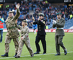Members of the Armed Forces on the park at half-time