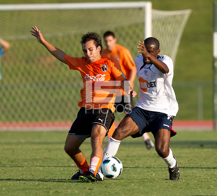 Diego Martins (CE) and Jlloyd Samuel (BW) contest the ball.  The Charlotte Eagles currently in 3rd place in the USL second division played a friendly against the Bolton Wanderers from the English Premier League losing 3-0..