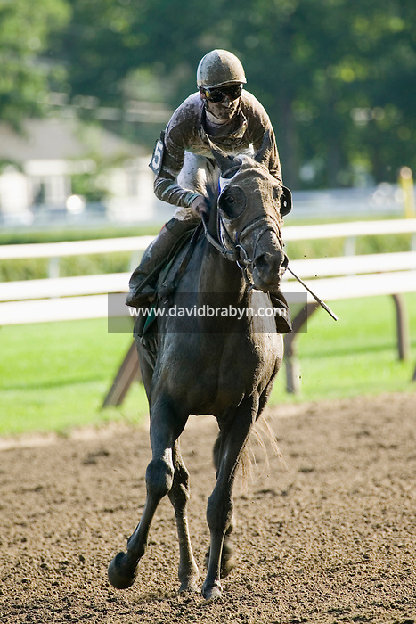French jockey Julien Leparoux rides back to the track exit after a race in Saratoga Springs, NY, United States, 4 August 2006.<br />