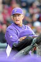 Head coach Ron Smith (10) of the Furman Paladins in a game against the South Carolina Gamecocks on Wednesday, April 3, 2013, at Fluor Field at the West End in Greenville, South Carolina. (Tom Priddy/Four Seam Images)