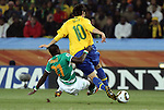 20 JUN 2010: Emmanuel Eboue (CIV) (21) and Kaka (BRA) (10). The Brazil National Team defeated the C'ote d'Ivoire National Team 3-1 at Soccer City Stadium in Johannesburg, South Africa in a 2010 FIFA World Cup Group G match.