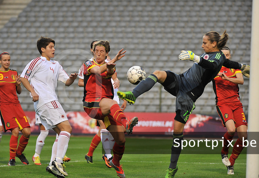 20130921 - BRUSSELS , BELGIUM : Albianan Goalkeeper Gjyli Pellumbesha pictured in a duel with Belgian Aline Zeler (middle) during the female soccer match between Belgium and Albania , on the first matchday in group 5 of the UEFA qualifying round to the FIFA Women World Cup in Canada 2015 at the Koning Boudewijn Stadion , Brussels . Saturday 21th September 2013. PHOTO DAVID CATRY