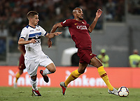 Calcio, Serie A: Roma - Atalanta, Stadio Olimpico, 27 agosto, 2018.<br /> Roma's Steven Nzonzi (r) in action with Atalanta's Mario Pasalic (l) during the Italian Serie A football match between Roma and Atalanta at Roma's Stadio Olimpico, August 27, 2018.<br /> UPDATE IMAGES PRESS/Isabella Bonotto