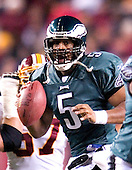 Philadelphia Eagles quarterback Donovan McNabb (5) fakes a hand-off in game action against the Washington Redskins in Landover, Maryland on December 12, 2004.  The Eagles won the game 17 - 14..Credit: Ron Sachs / CNP