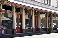 Head Start, Kathmandu Trading Company and other businesses on Waianuenue Avenue, downtown Hilo, Big Island of Hawai'i.