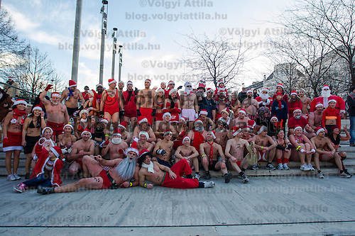 "Participants pose for a group photo after a half naked ""Santa run"" organised the 5th time to support a charity in Budapest, Hungary on December 09, 2012. ATTILA VOLGYI"