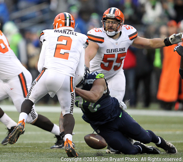 Seattle Seahawks defensive end Michael Bennett (72) forces Cleveland Browns quarterback Johnny Manziel (2) to fumble the ball at CenturyLink Field in Seattle, Washington on December 20, 2015. The Seahawks clinched their fourth straight playoff berth in four seasons by beating the Browns 30-13.  ©2015. Jim Bryant Photo. All Rights Reserved.