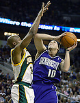 Sacramento Kings'  Mike Bibby, R, is fouled while going to the basket by Seattle SuperSonics'  Ray Allen in the second period of their first round playoff game at Key Arena in Seattle, Washington Saturday, 23 April  2005..Jim Bryant Photo. ©2010. All Rights Reserved.