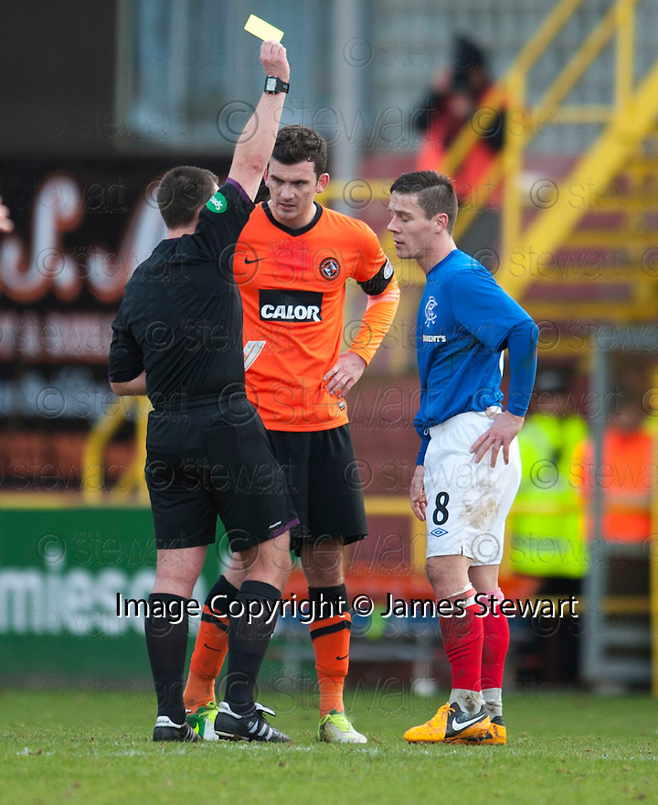 Gers Ian Black receives his first yellow card.