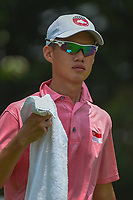 Joshua HO (SIN) towels off as he heads down 5 during Rd 2 of the Asia-Pacific Amateur Championship, Sentosa Golf Club, Singapore. 10/5/2018.<br /> Picture: Golffile | Ken Murray<br /> <br /> <br /> All photo usage must carry mandatory copyright credit (© Golffile | Ken Murray)